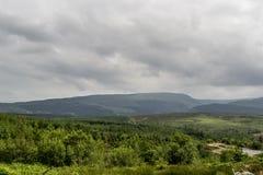 Grey Clouds Over Landscape fotos de archivo