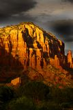 Grey clouds over red rock mountains Stock Photos