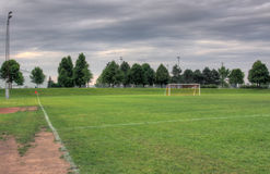 Grey Clouds and Soccer Field Stock Photography