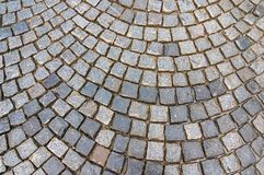 Grey cobblestone pavement after the rain Stock Photos