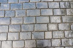 Grey cobblestone pavement after the rain Royalty Free Stock Image
