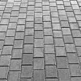 Grey Cobblestone Pavement Texture Background, grande Gray Stone Block Paving Perspective vertical detalhado, godo Textured áspero fotos de stock royalty free