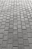 Grey Cobblestone Pavement Texture Background, großer ausführlicher vertikaler Gray Stone Block Paving Perspective, rauer struktur Lizenzfreie Stockfotografie
