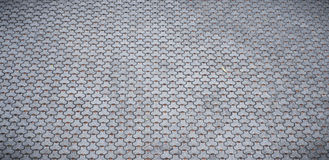 Grey cobblestones. Grey cobblestone pavement background texture Stock Photography