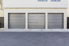 Grey colored three car garage Royalty Free Stock Images