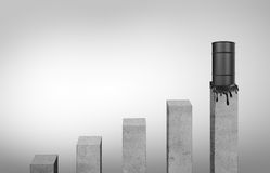 Grey columns standing in ascending order and leaking oil barrel on highest one Stock Photography