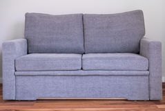 Grey comfortable sofa Stock Photos