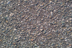 Grey concrete background with little stones Royalty Free Stock Photo