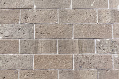 Grey concrete brick wall background of exterior building. The grey concrete brick wall background of exterior building stock photo