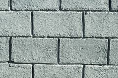 Grey concrete brick wall photo background. Rough grey stone brick. Stock Images