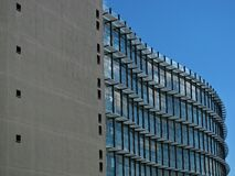 Grey Concrete Building With Blue Windows Stock Image