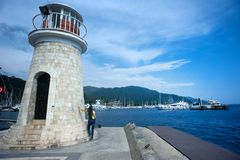 Grey Concrete Lighthouse Near Ocean Stock Photo
