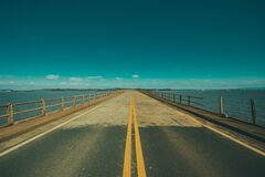 Grey Concrete Road in the Middle of the Sea Royalty Free Stock Image