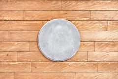 Grey concrete signboard on wooden background royalty free stock images