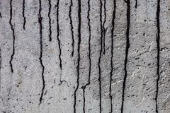 Grey concrete surface with black bitumen streaks Stock Image