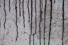 Grey concrete surface with black bitumen streaks Stock Image
