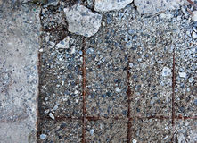 Grey concrete surface with visible reinforcement and crushed sto Royalty Free Stock Images