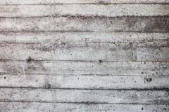 Grey concrete wall with hardened traces of the shuttering moulds Royalty Free Stock Photography