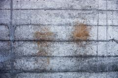 Grey concrete wall with hardened traces of the shuttering moulds Royalty Free Stock Photo