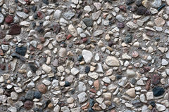Grey concrete wall with stones background and texture Royalty Free Stock Images