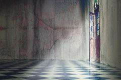 Grey concrete wall with tile floor with classic door open Royalty Free Stock Images
