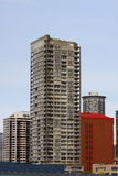 Grey Condo Tower by Red Brick Stock Images