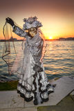 Grey costumed masked woman. Standing at San Giorgio in Venice Stock Photos