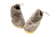 Grey cosy slippers Stock Photos