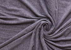 Grey cotton. Fabric swirl background Royalty Free Stock Photography