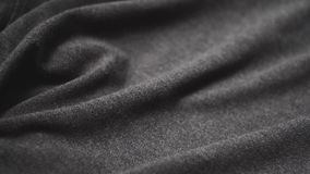 Grey cotton fabric. Use as a background. Panoramic slow-motion stock footage