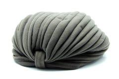 Grey Cotton hatt och sjalett på vit bakgrund Royaltyfria Foton