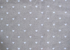 Grey cotton napkin with hearts. decorated background for valentines day Royalty Free Stock Photo