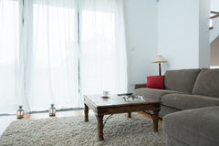 Grey couch and coffee table Royalty Free Stock Images