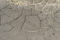 Grey cracked asphalt road Royalty Free Stock Photo