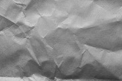 Grey creased wrapping paper background texture royalty free stock image