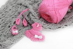 Grey crocheted material and skein. Grey crocheted material, pink skein, dress, bag and shoes Royalty Free Stock Photography