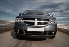 Grey crossover driving fast Stock Images