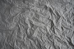 Grey crumpled wrapping paper background, texture of grey wrinkled of old vintage paper, creases on the surface of gray paper. royalty free stock photos
