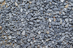 Grey crushed granite pebbles, background image Royalty Free Stock Image
