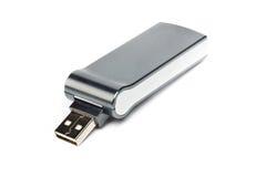 Grey curvy usb flash drive. Studio photo of grey USB flash storage on white background Royalty Free Stock Photography