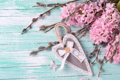 Grey decoratve heart with hyacinths, willow flowers Royalty Free Stock Images