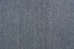 Grey, denim texture. Fabric texture of the jeans Stock Images