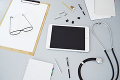 Grey desk top with empty tablet Royalty Free Stock Photos