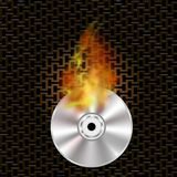 Grey Digital Burning Disc with Fire and Flame. Grey Digital Burning Compact Disc with Fire and Flame on Dark Steel Perforated Grid Royalty Free Stock Photography