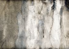 Grey dirty wall with spots and stains stock photography