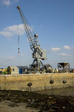 Dockyard crane on a jetty. Guernsey Royalty Free Stock Photo