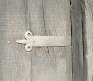 Grey door hinge on wooden door Royalty Free Stock Image
