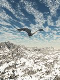 Grey Dragon Flying over the Mountains. Fantasy illustration of a grey dragon flying over snowy winter mountains, 3d digitally rendered illustration Royalty Free Stock Photos