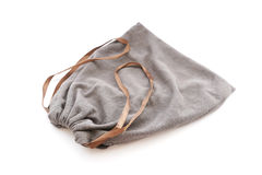 Grey drawstring pouch with brown ribbon Royalty Free Stock Images