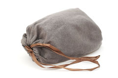 Grey drawstring pouch with brown ribbon Royalty Free Stock Photography